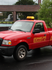 Phelps Security Red Patrol Truck